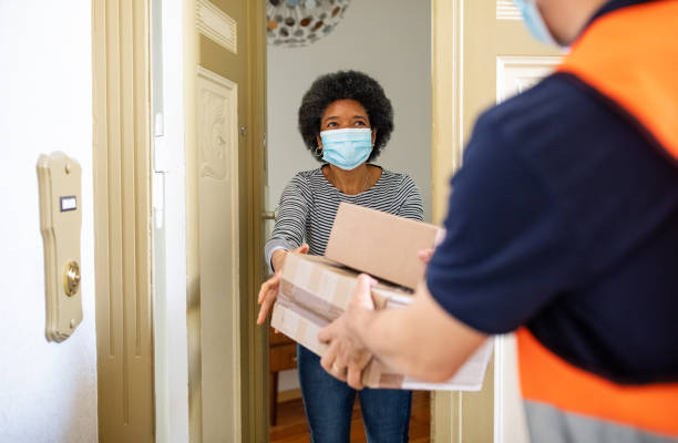 mature woman getting package from delivery person during pandemic picture id1223161054?k=20&m=1223161054&s=612x612&w=0&h=q1SxPass ipTcgEI7pzK7L2ul