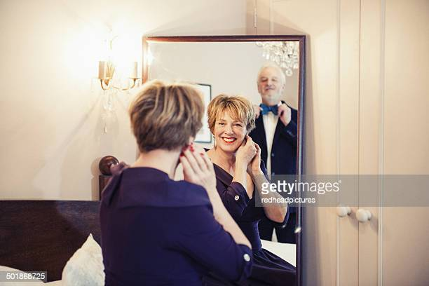 Mature woman getting ready looking in mirror
