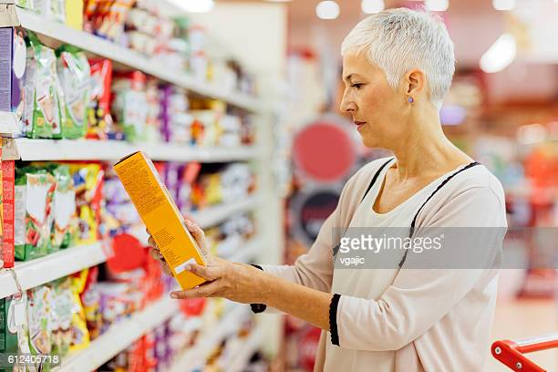 mature woman groceries shopping. - ingredient stock pictures, royalty-free photos & images
