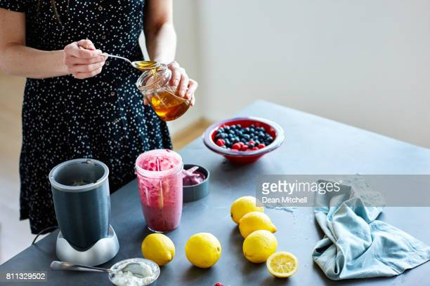 Mature woman hands preparing a smoothie