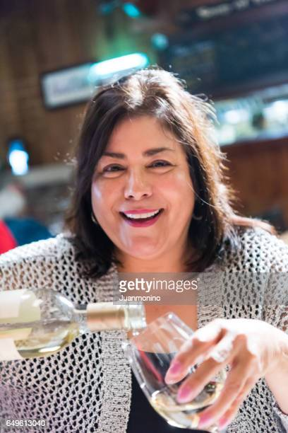 mature woman having a glass of wine in a tavern - drunk mexican stock pictures, royalty-free photos & images