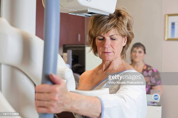 mature woman having a mammogram. - mammogram stock pictures, royalty-free photos & images