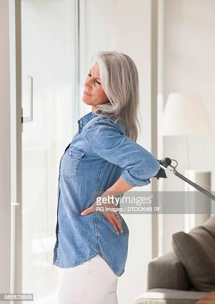 Mature woman having back pain