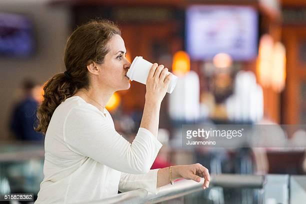 mature woman having coffee
