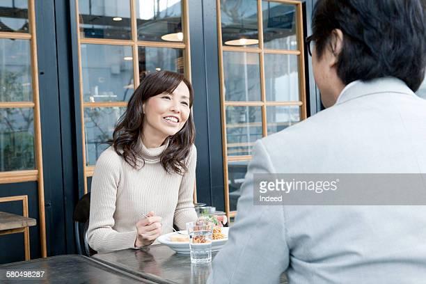 Mature woman having lunch with senior man at restaurtant
