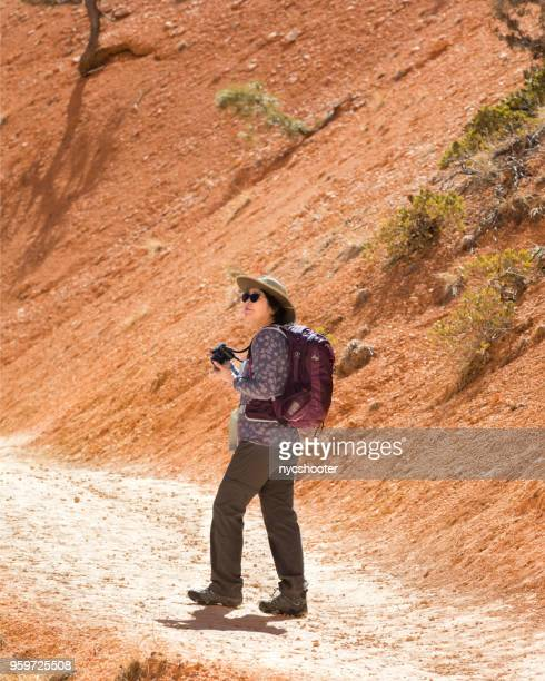mature woman hiking bryce canyon national park - amateur stock pictures, royalty-free photos & images