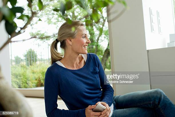 Mature woman holding cell phone