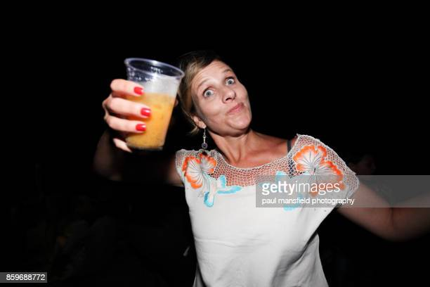 mature woman holding drink at night time - drunk woman stock pictures, royalty-free photos & images