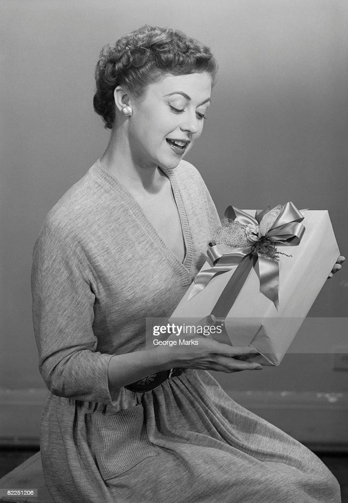 Mature woman holding gift box : Stock Photo