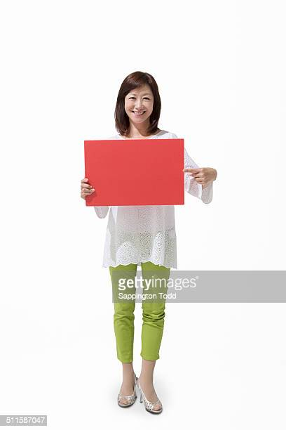 Mature Woman Holding Placard