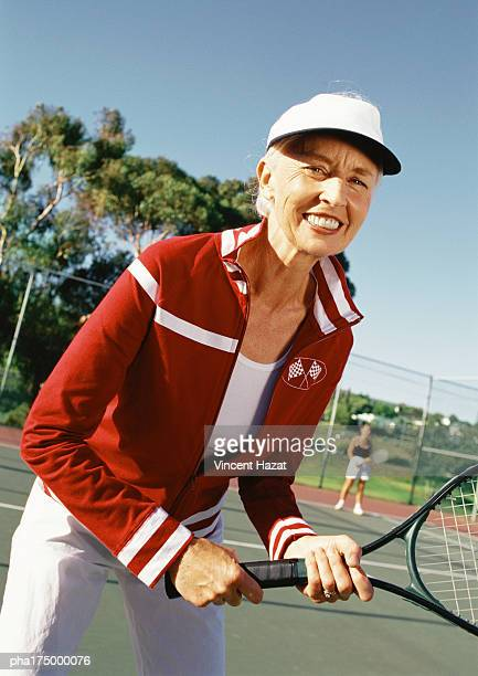 mature woman holding tennis racket, portrait - doubles stock pictures, royalty-free photos & images