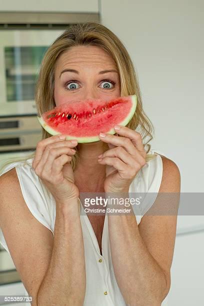 Mature woman holding watermelon