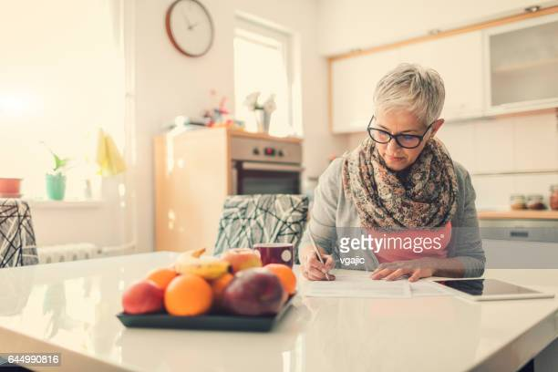 Mature woman Home budgeting