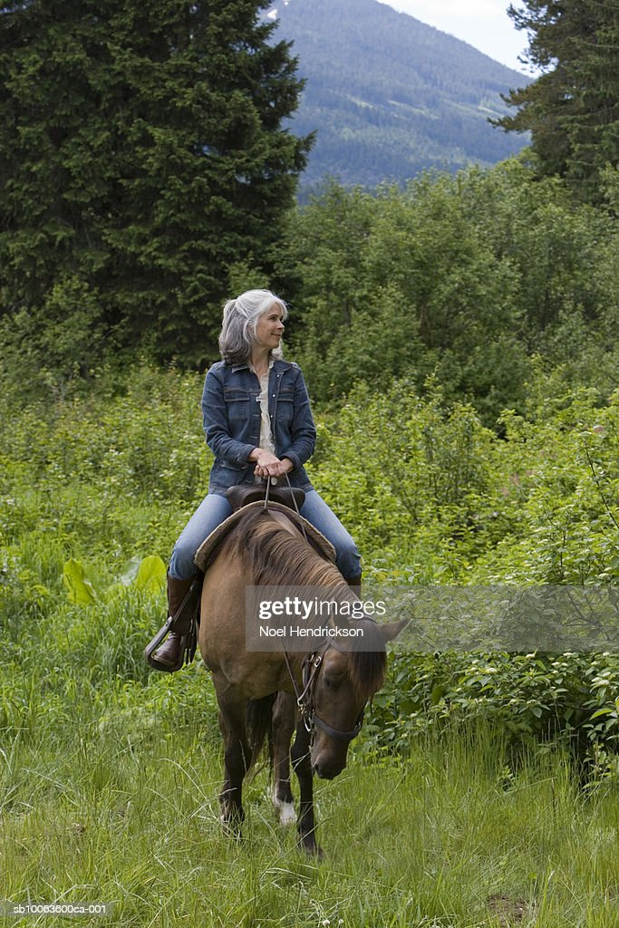 Mature women riding