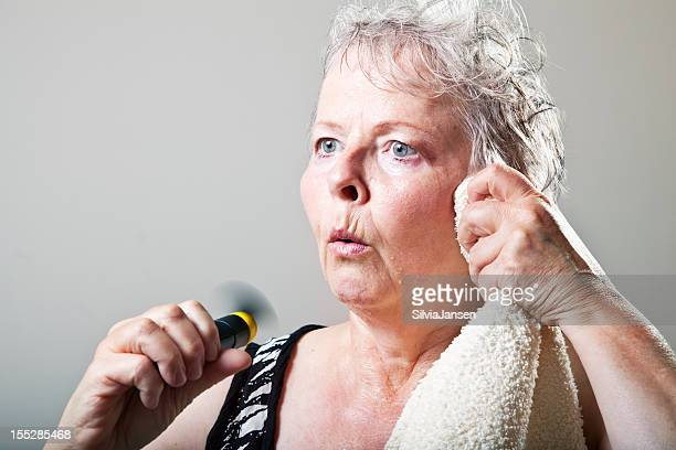 mature woman hot flash menopause portrait - fat old lady stock photos and pictures