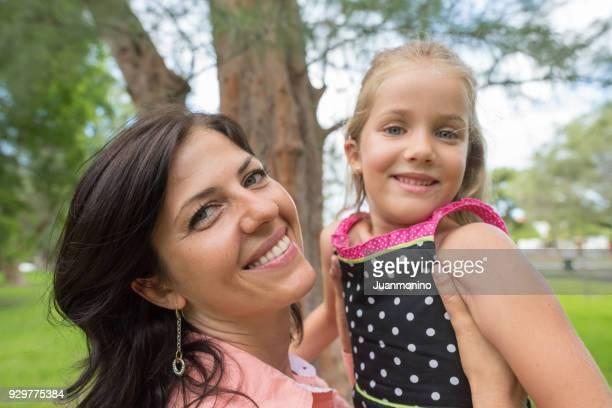Mature woman hugging her daughter