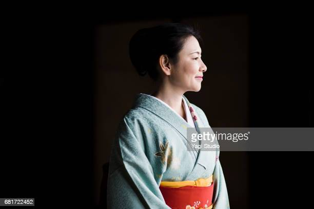 Mature woman in a kimono at a temple