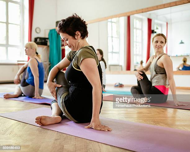 Mature Woman In Aerobics Class Stretching
