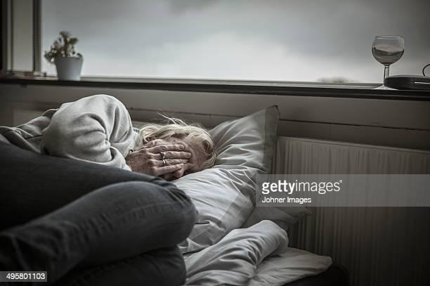 Mature woman in bed, Ronneby, Blekinge, Sweden