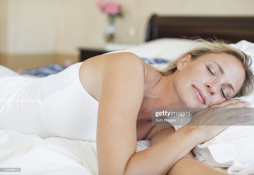 Mature woman in bed sleeping peacefully : Stock Photo