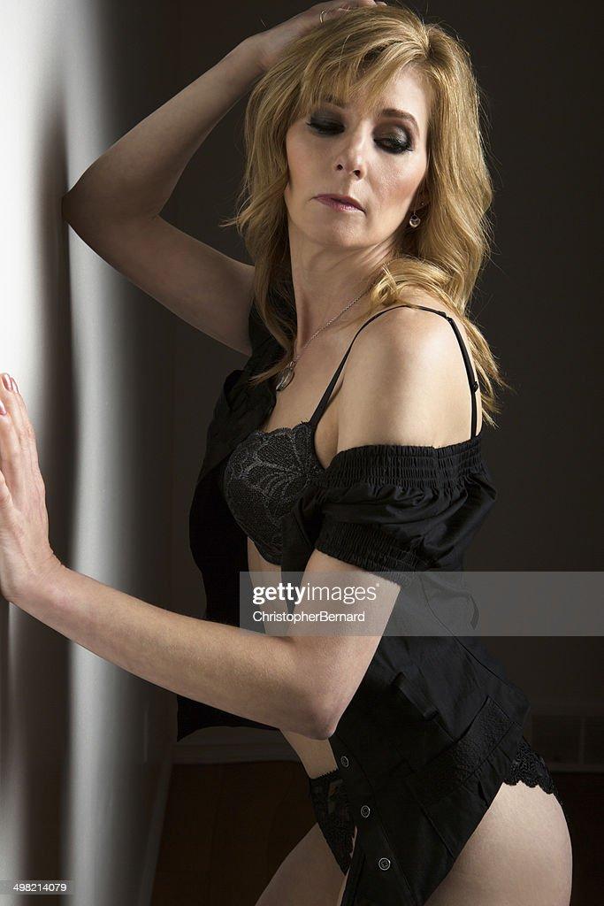 Mature Woman In Black Lingerie Bildbanksbilder