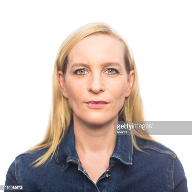 mature woman in casuals staring at camera - caucasian ethnicity stock pictures, royalty-free photos & images