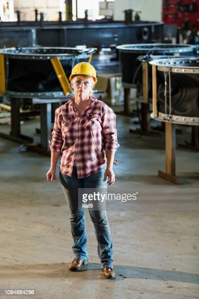 Mature woman in metal fabrication plant