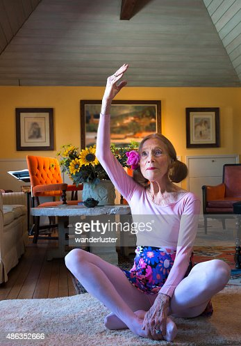 Mature Woman In Pink Leotard Stretches Stock Photo Getty