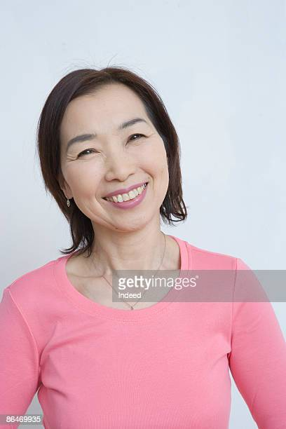 Mature woman in pink shirt, portrait