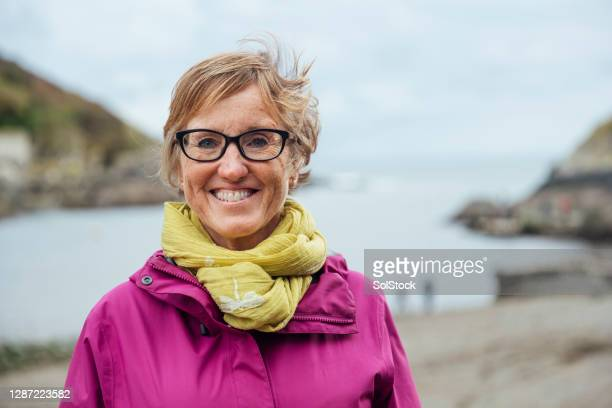 mature woman in polperro - one woman only stock pictures, royalty-free photos & images