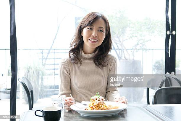 Mature woman in restaurant
