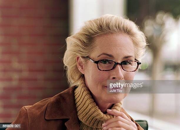mature woman in suede jacket, portrait - northern european descent stock pictures, royalty-free photos & images