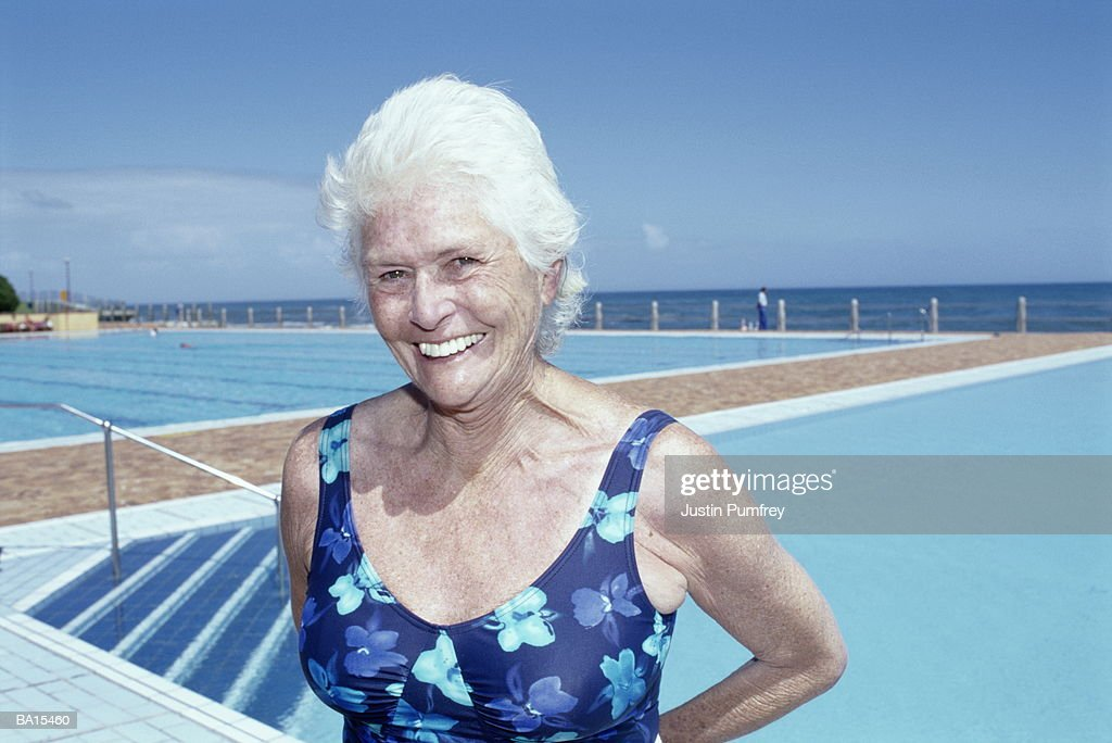 Mature Woman In Swimsuit By Outdoor Pool Smiling Portrait Closeup High-Res Stock Photo -1161
