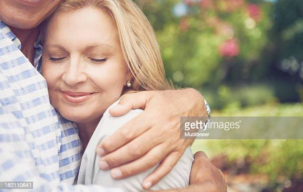 Mature woman in the arms of her husband