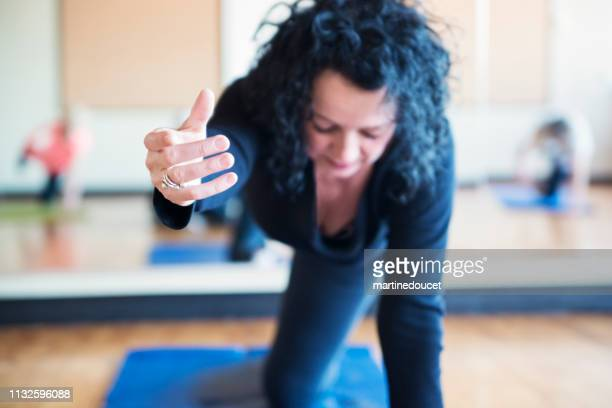 mature woman instructor of stretching class. - showus stock pictures, royalty-free photos & images