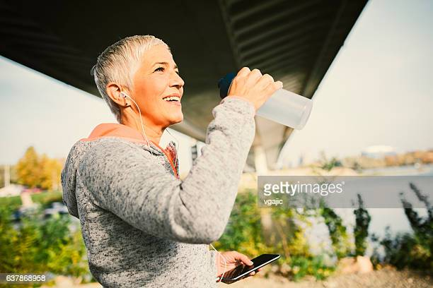 Mature Woman Jogging In The City