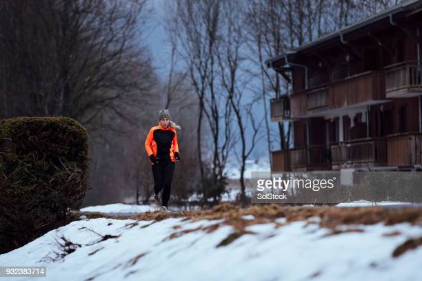 Mature Woman Jogging on a Snowy Morning