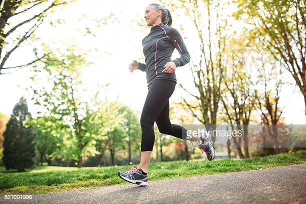 Mature Woman Jogging Outdoors