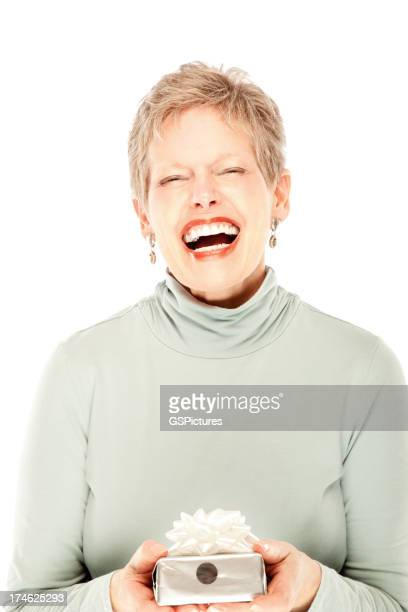 Mature woman laughing and holding a gift.