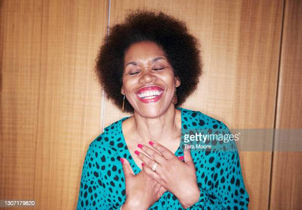 mature woman laughing - tax stock pictures, royalty-free photos & images