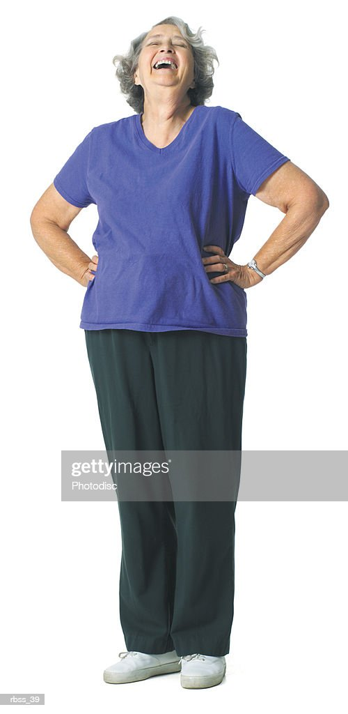 Mature woman laughing with hands on her hip : Foto de stock