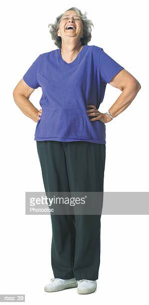 mature woman laughing with hands on her hip - one senior woman only stock pictures, royalty-free photos & images