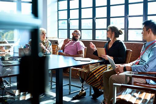 Mature woman leading team meeting in board room - gettyimageskorea