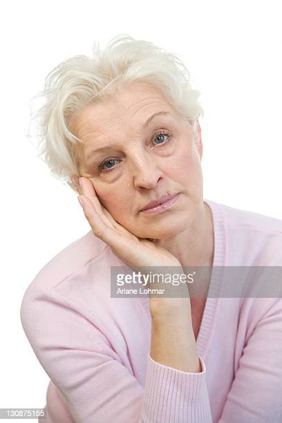 a mature woman looking bored - 50 59 years stock pictures, royalty-free photos & images