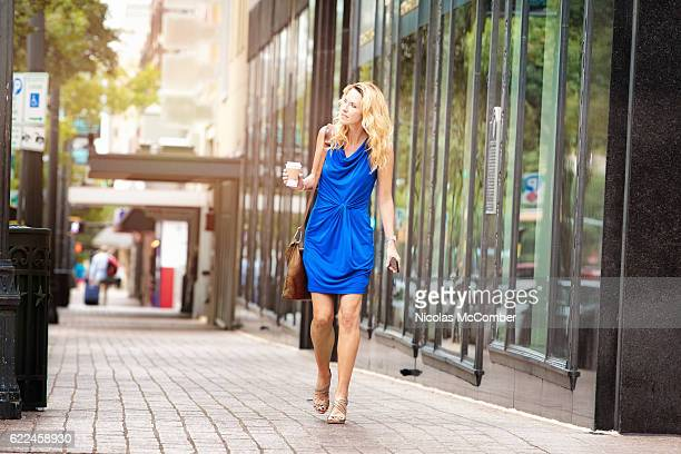 mature woman looking for direction downtown austin texas - sleeveless top stock photos and pictures