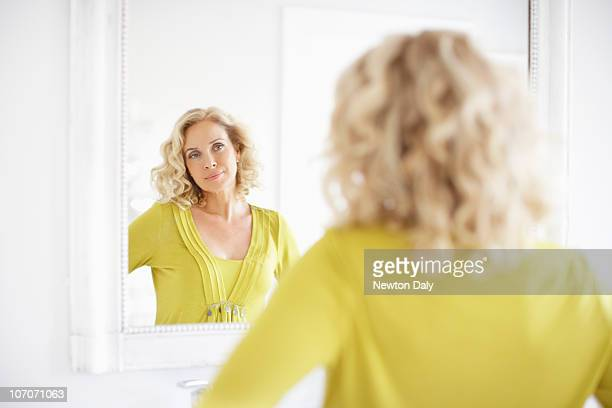 mature woman looking in mirror93 mirror