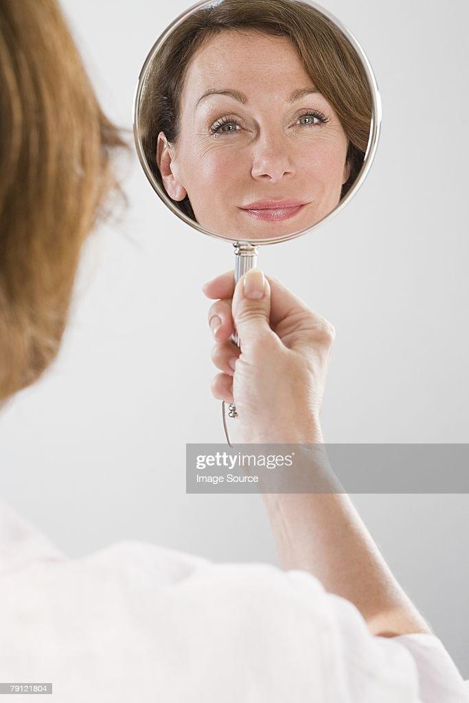 looking in mirror. Fine Mirror Mature Woman Looking In Mirror  Stock Photo With Looking In Mirror