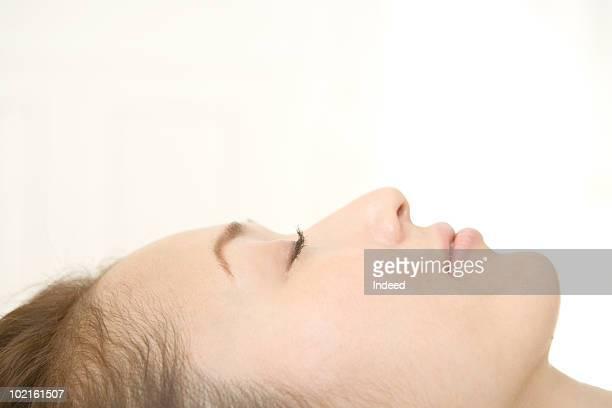 Mature woman lying, portrait