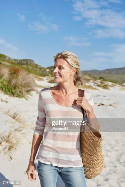 Mature woman making a beach walk