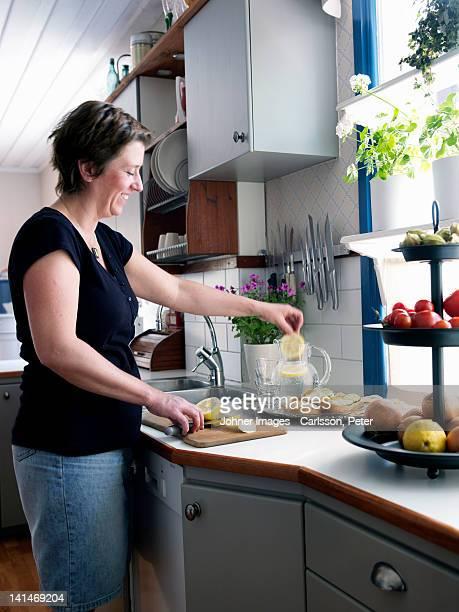 Mature woman making lemonade